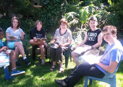 Lorna reading with kids outside